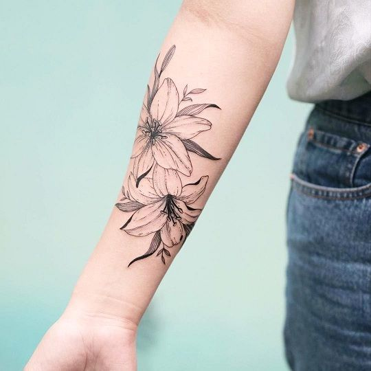 25 Interesting Lily Tattoos Designs And Their Meanings Styles At Life Lily Tattoo Design Lily Tattoo Lily Flower Tattoos