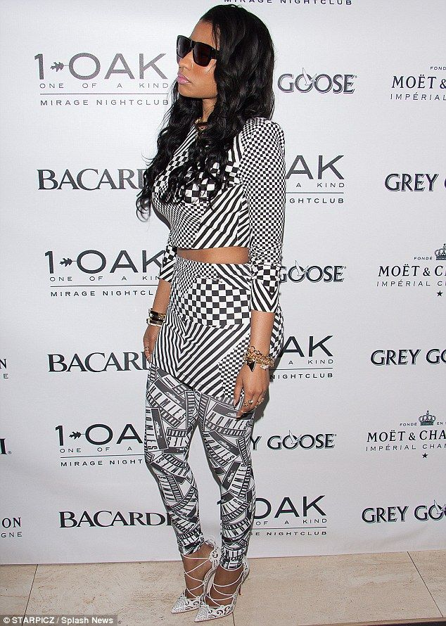 2a50ca86ea2d7 Fancy footwear  Nicki Minaj gave herself a boost with a pair of exquisite  and dainty pointed toe white pumps