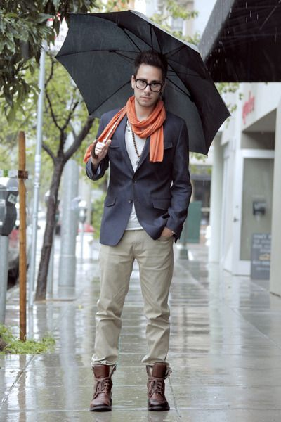 The rain can't beat the style. This is so 'Singing In The Rain' musical. Love it.