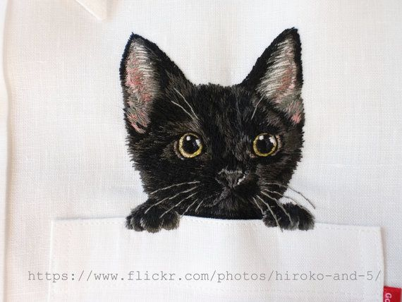 hand embroidered black kitten in the pocket in the white linen shirt for men