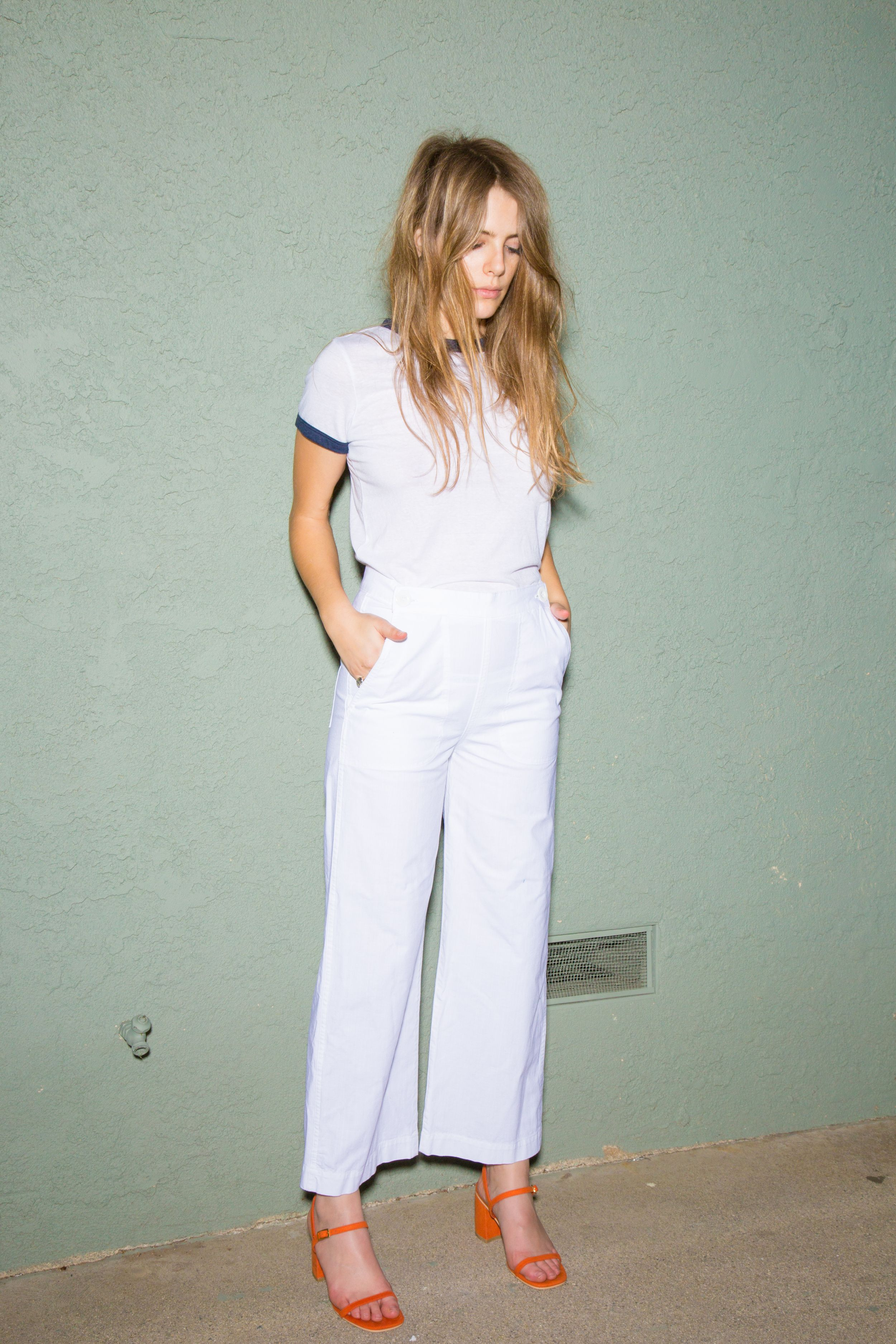 A classic nautical cut, these front flap flares have white enamel buttons for closure plus a hidden zip. ...