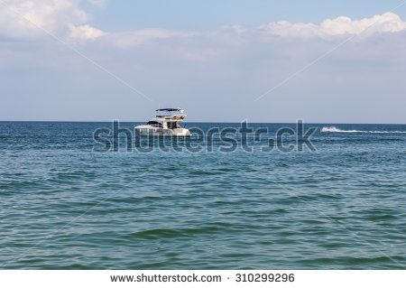 Seascape with motor boat