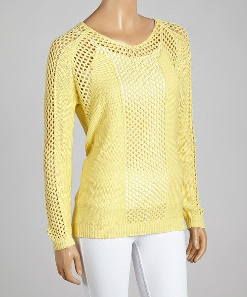 Perfectly+sweet,+this+sweater+is+designed+to+delight.+A+loose+knit+creates+feminine+allure,+while+a+yellow+hue+adds+pastel+appeal.