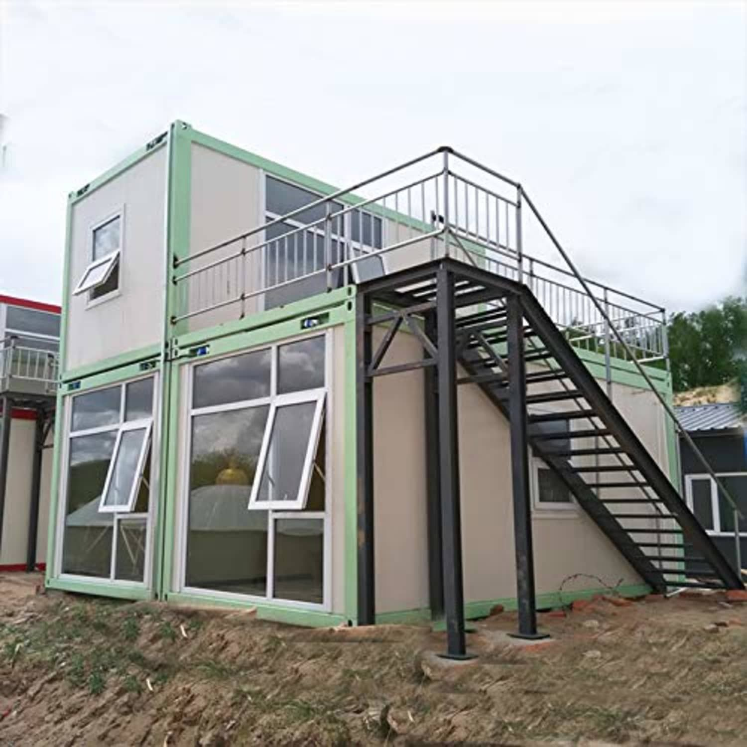 This Prefab Container House Sleeps Four And Has A Roof Deck Container House Prefab Prefab Homes