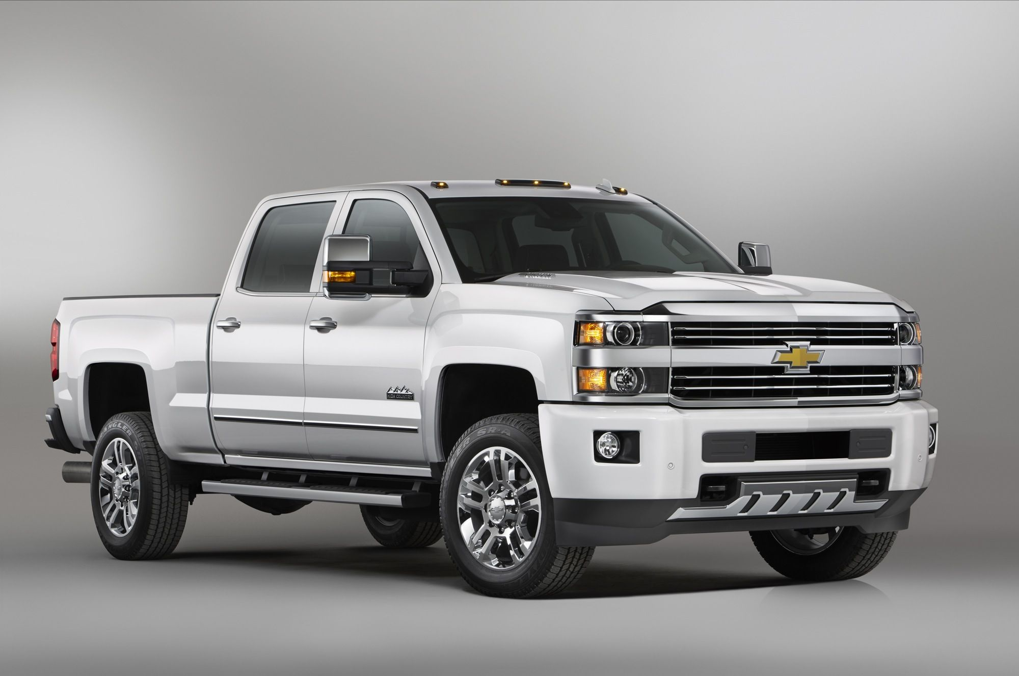 The 2015 chevrolet silverado high country hd the brand s first high end heavy duty pickup truck will arrive at dealerships this summer
