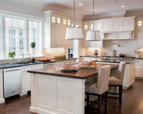 Kitchen Island Feet the 17-by-23-foot kitchen's two islands afford easy traffic flow