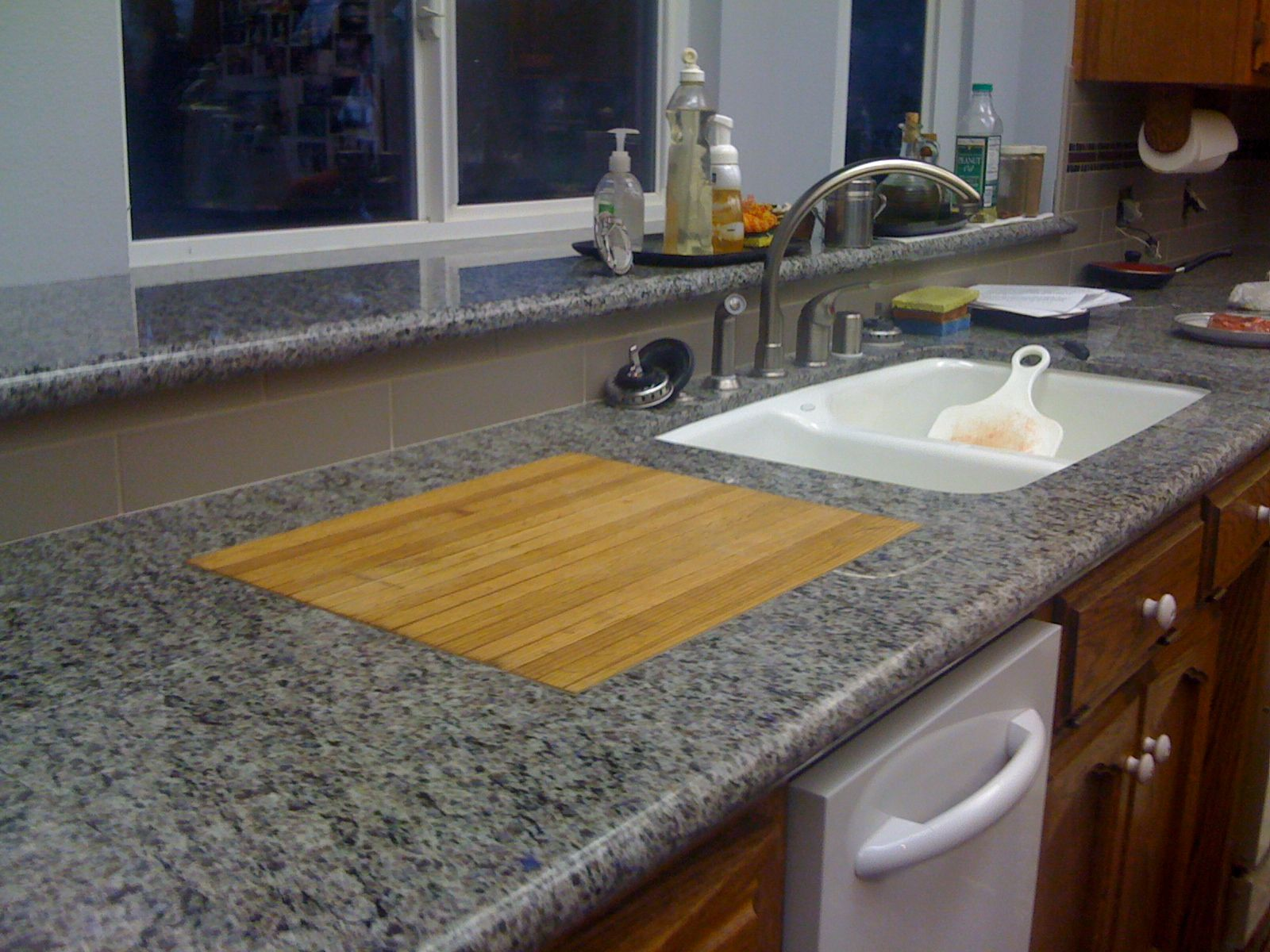 Granite Countertop With Wood Cutting Board Mounted Flush In The Stone