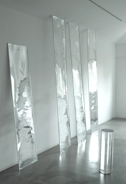 Laser etched acrylic designs- seem invisible but make amazing shadows!!!  Adam Thompson . 2011