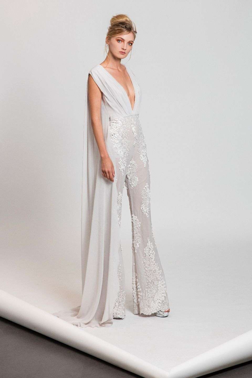 pearl white silk jumpsuit with deep v neckline and