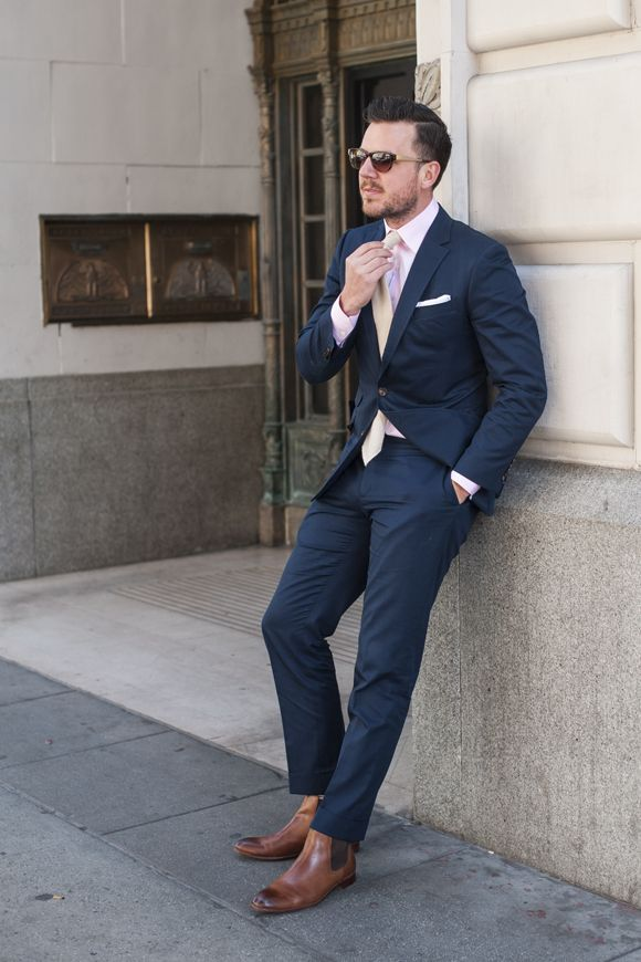 Navy blue suit, brown shoes, light yellow tie, light, red or pink