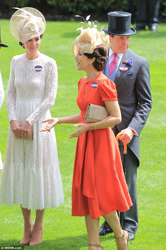 Royal Ascot 2016: The Duchess of Cambridge, dressed in an ethereal white lace Dolce & Gabbana dress, looked enthused as she chatted with Australian-born Princess Mary of Denmark, who looked vibrant in an orange dress by Marc Jacobs.