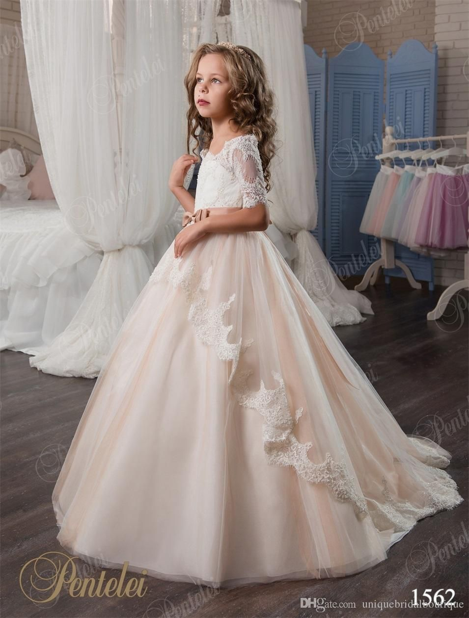 Kids wedding dresses 2017 pentelei with illusion long sleeves and 2017 vintage flower girls dresses pentelei with bow and 21 sleeves ball gown champagne ombrellifo Images