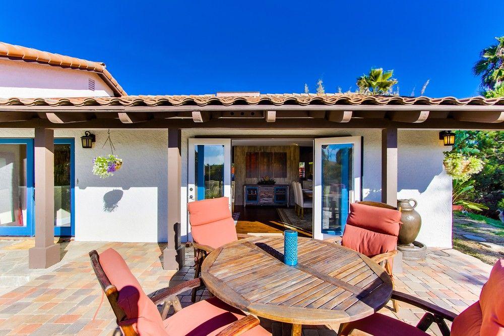 Best Spanish Style Home With White Stucco Red Clay Roof Mixed Color Paver Patio Wood Beams And 400 x 300