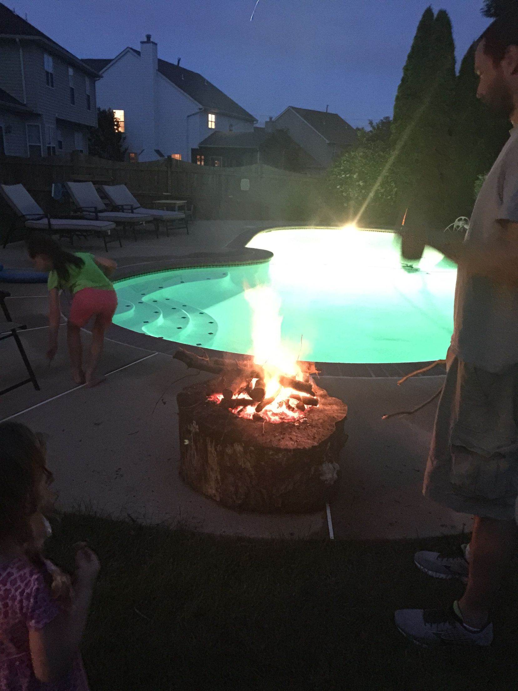 Created a fire pit out of a large log... Lots of fun in the backyard.