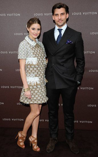 : At the Louis Vuitton Maison opening in Munich, Olivia Palermo — pictured with boyfriend Johannes Huebl — mixed high with low in a metallic collared Louis Vuitton Resort '13 dress and tan suede Zara sandals.