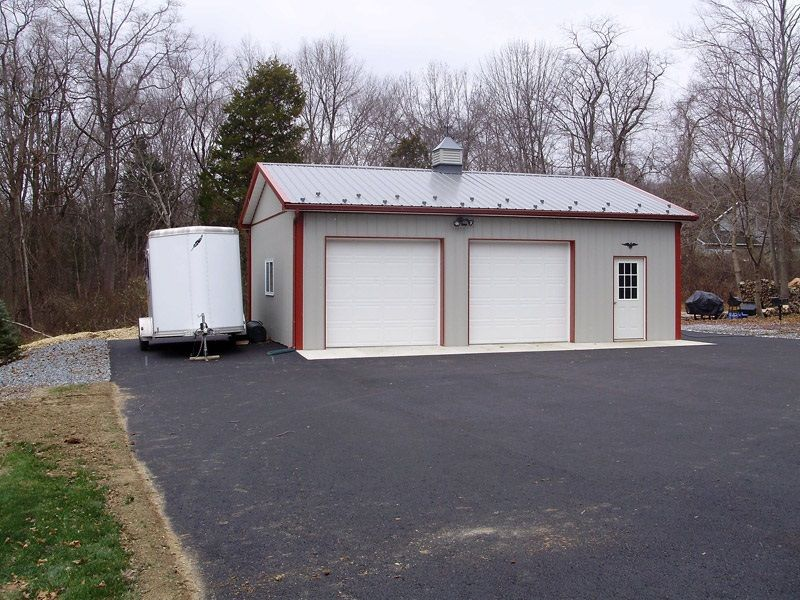 Dimensions: 24' W x 32' L x 10' H (ID# 111) 24' Standard Trusses, 4' on Center, 4/12 Pitch  Colors: Siding Color: Ash Gray Roofing Color: Charcoal Trim Color: Red  Visit: http://pioneerpolebuildings.com/portfolio/project/24-w-x-32-l-x-10-h-id-111-total-cost-12447  Or Call: 1-888-448-2505  Pioneer Pole Buildings, Inc. 716 South Route 183 Schuylkill Haven, PA. 17972
