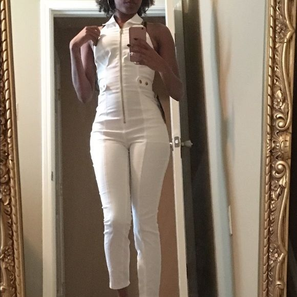 6d50c0863eca White denim jumpsuit Never worn. All white halter denim jumpsuit. No stretch  normally a side 00. bebe Jeans Overalls