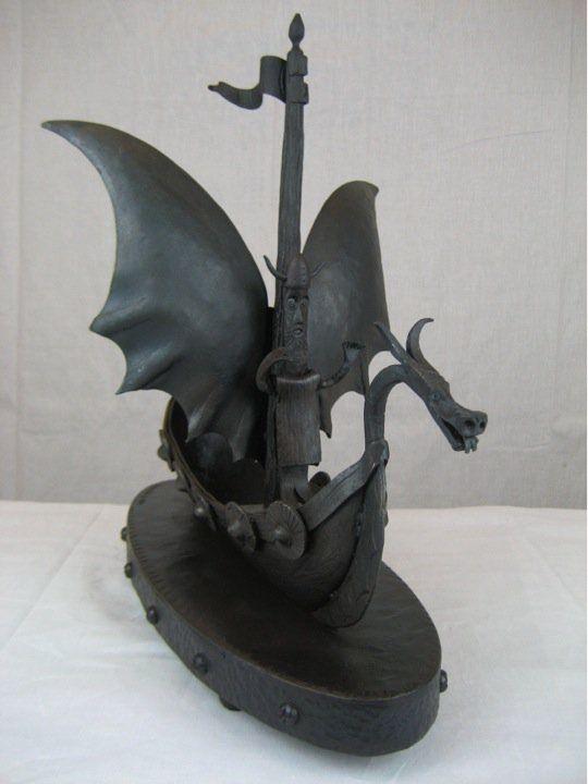 Viking on a dragon ship.