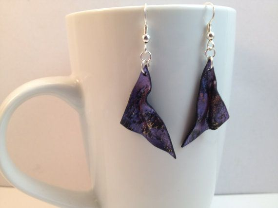 Dangling rippled leaf earrings in metallic purple by Felicianation $16