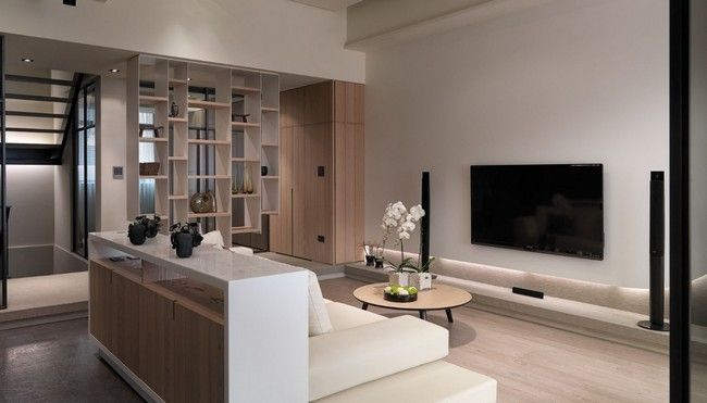 This multilevel contemporary apartment was designed by the taiwan based wch studio the interior is characterized by elegant pale neutrals