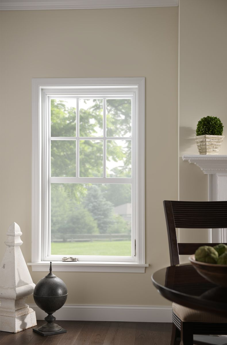 Single Hung Window With Grids Increase Natural Lighting Through A