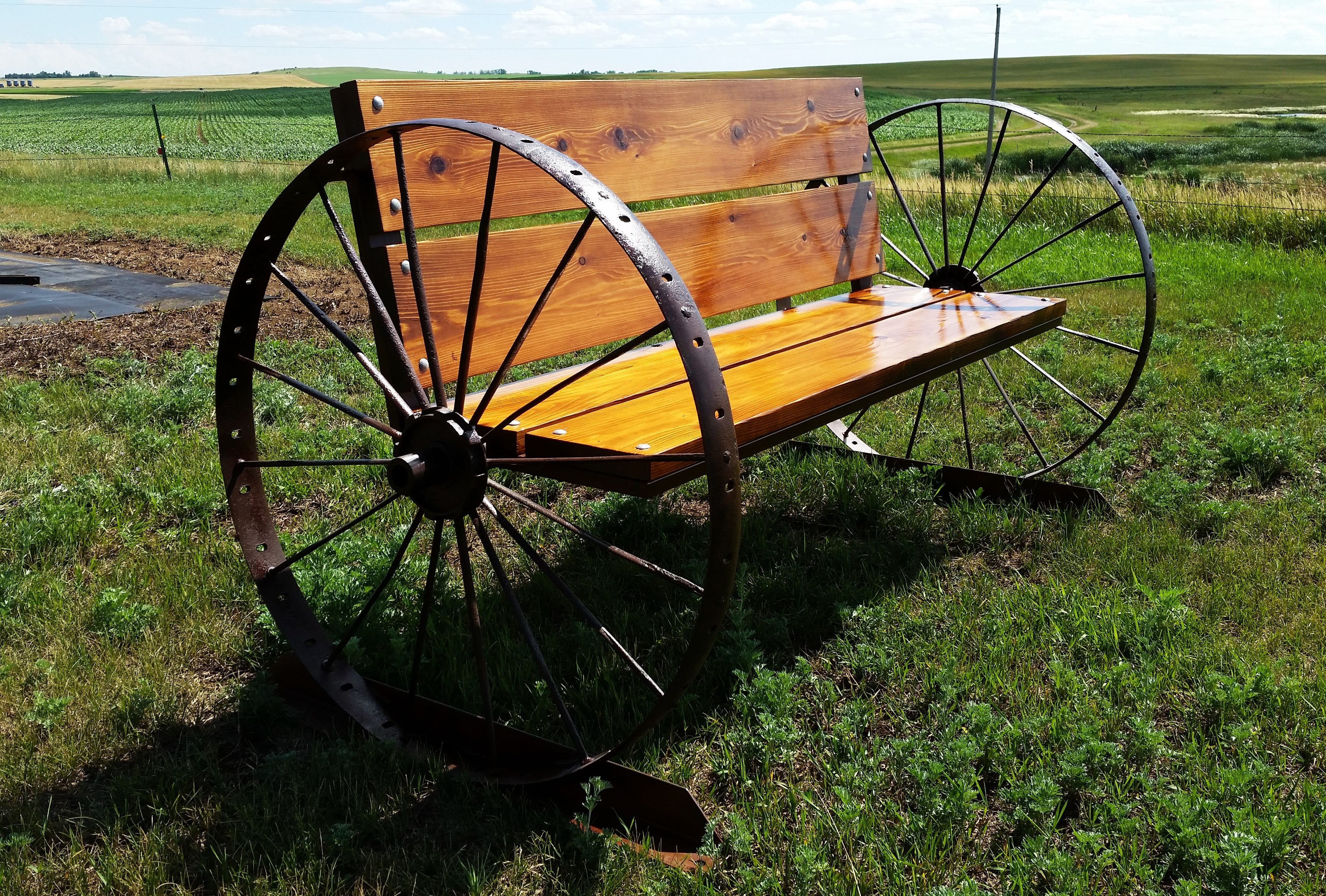 Bench That I Made Using A Pair Of Antique Steel Wheels And Cedar