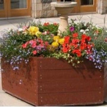 Marsden Hexagonal Recycled Planter. These planters can be used to create colourful corners and barriers between traffic and pedestrians. The recycled plastic does not rot and retains its attractive appearance. Diameter:1200mm. Weight:54kg.