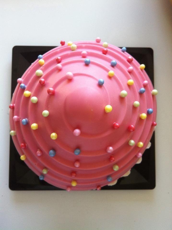 Close up, top giant pink candy melt cupcake