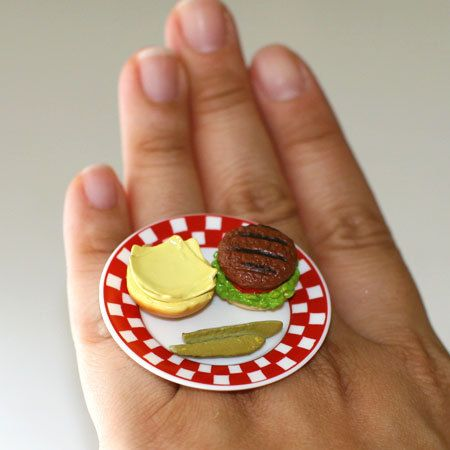 A Super Cute Plate With A Cheese Hamburger And Pickles