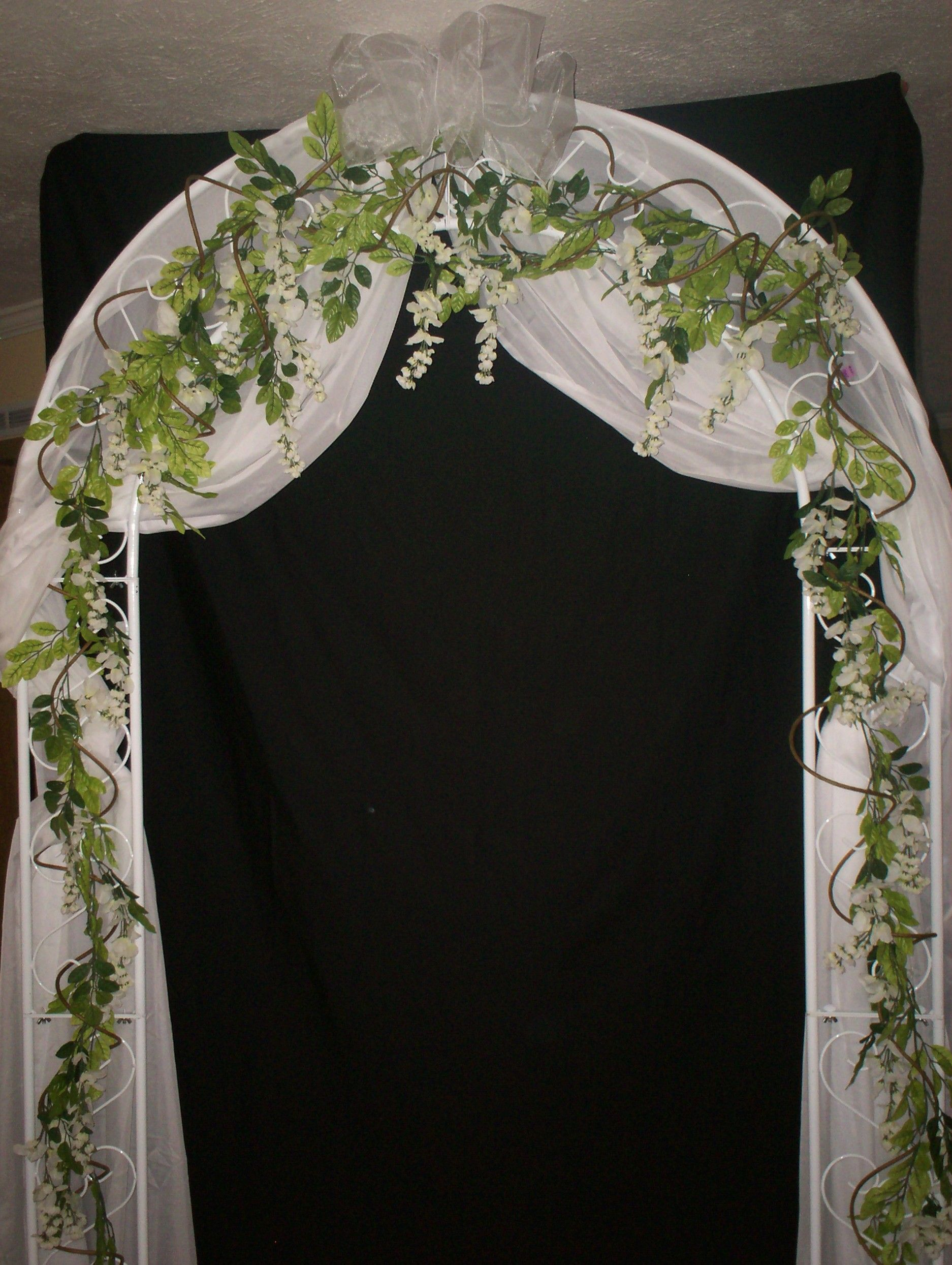 Wedding flower arrangements for arches wedding arch with hanging wedding flower arrangements for arches wedding arch with hanging curly wisteria vines and white organza junglespirit Gallery