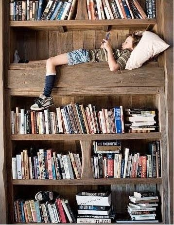 I love this photo.  I want to read a book in my bookcase surrounded my books.  Almost as comforting as being in the womb... except I don't remember being in the womb.