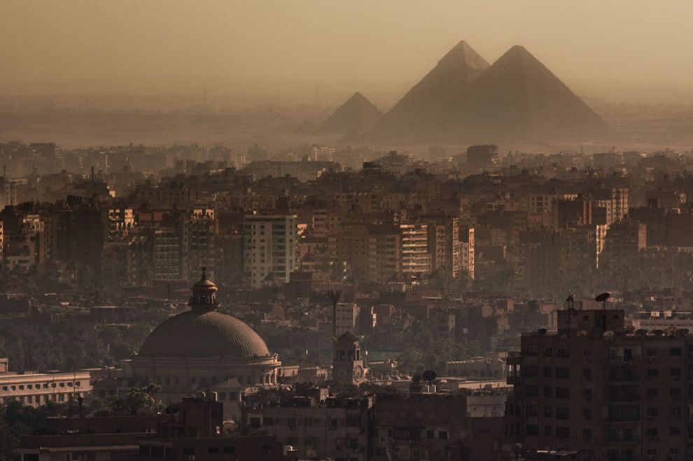 the majestic ancient pyramids of egypt We have to say that pyramids are surrounded by high fence with  here i am  admiring desert beauty of egyptian landscapes, passing by our airplane windows   you have to be there to experience their awesome majesty.
