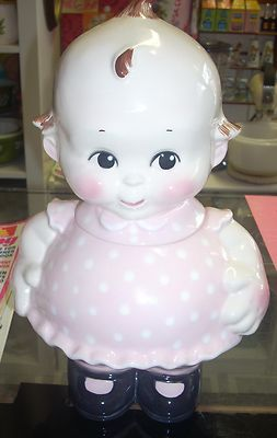 Cute Kewpie doll cookie jar at   www.jazzejunque.com