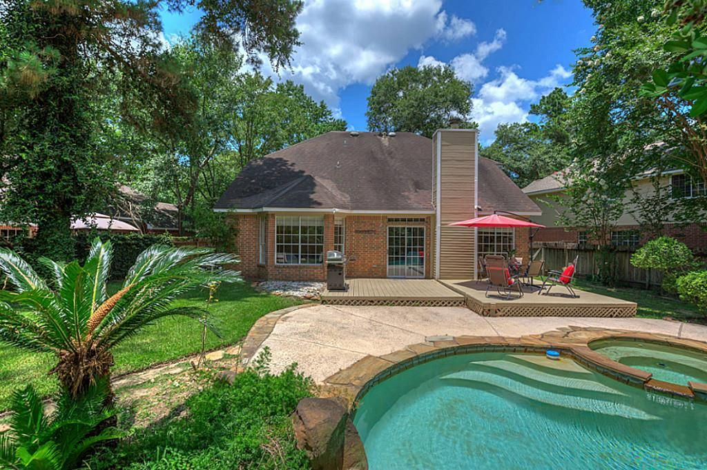 6 torch pine cir, The Woodlands, TX: Photo  gorgeous backyard and pool