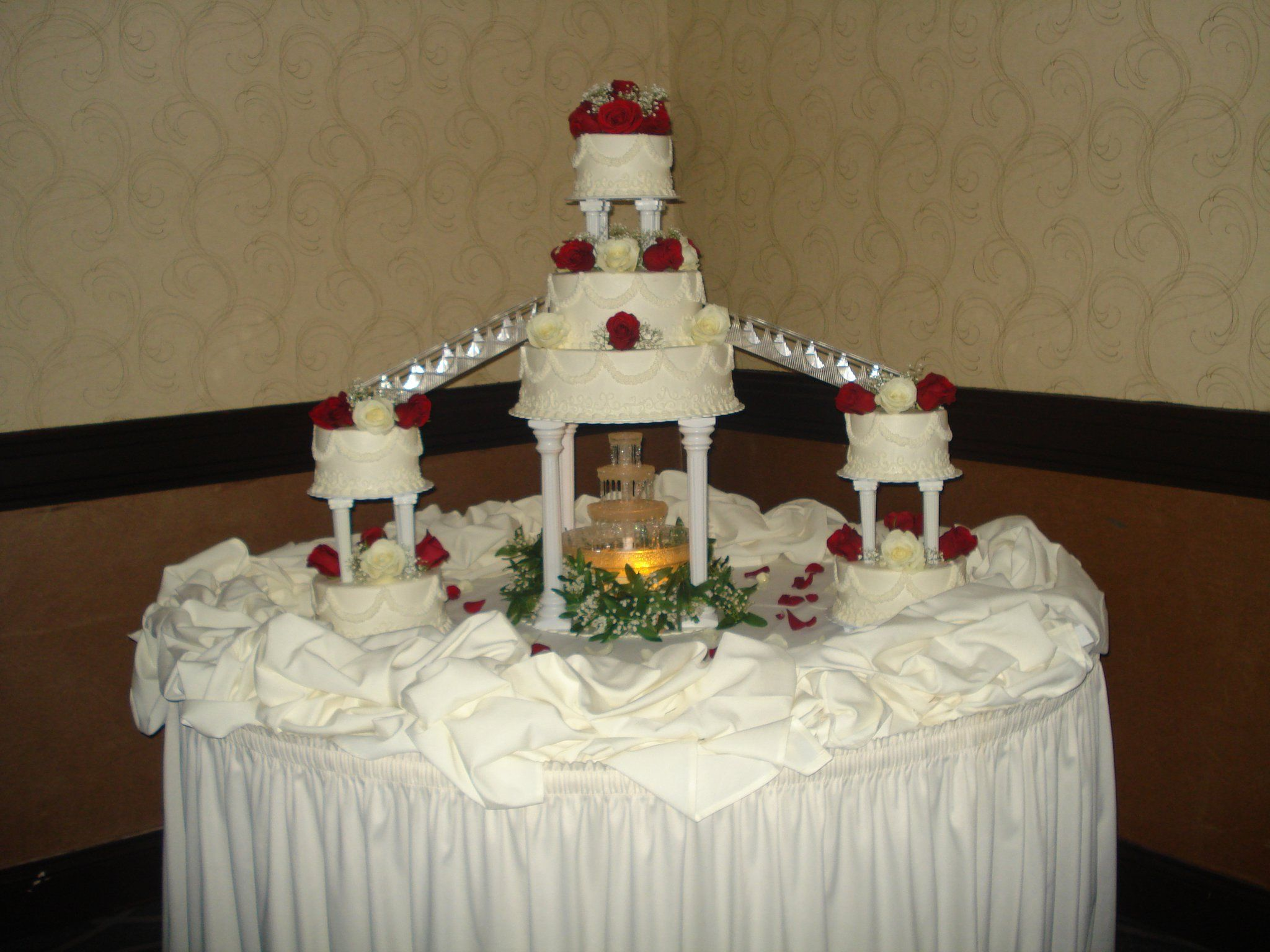 Oldfashioned wedding cake with stairs and fountain Old
