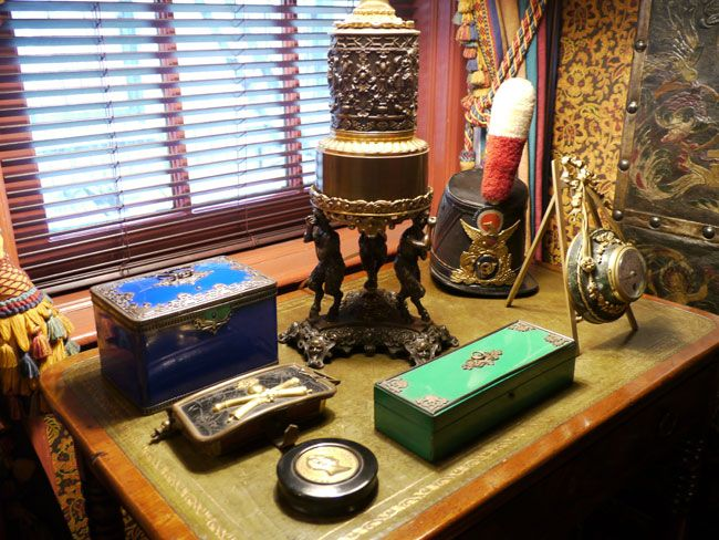Colored enamel boxes are arranged next to a bronze lamp from Judie's parents.. Weinstock