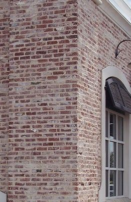 Red Brick White Shutters