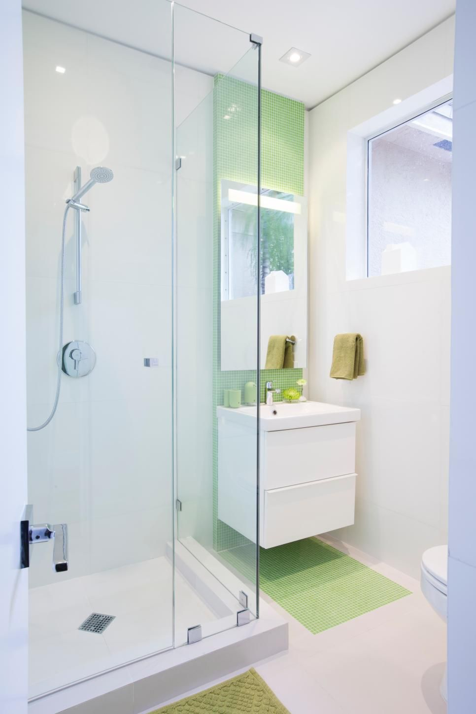 Drawing stylish green glass tile down from the ceiling and across ...