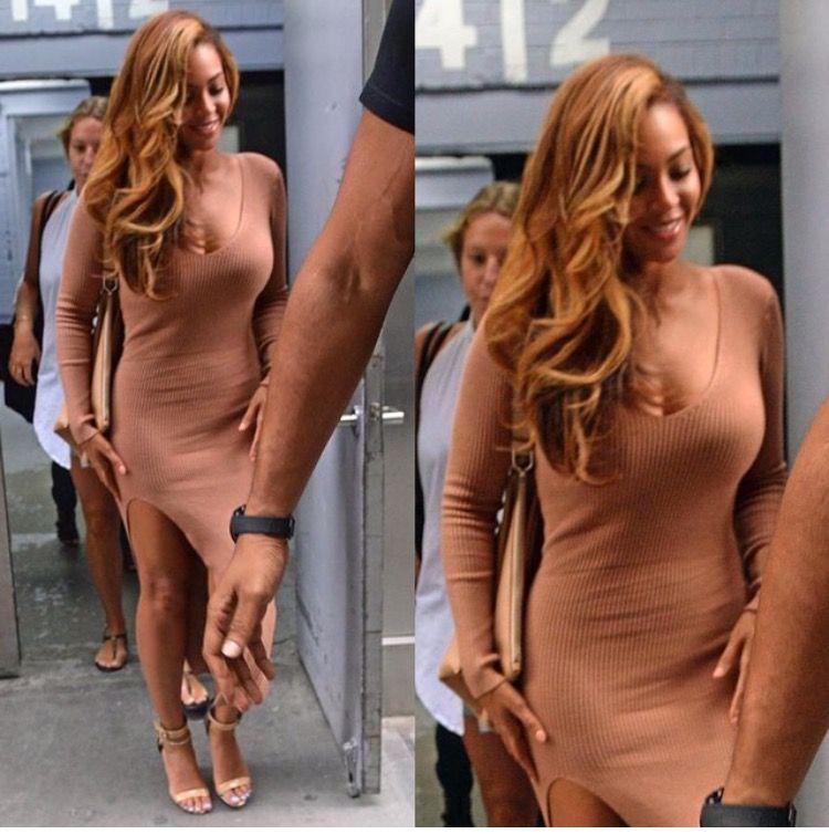 Beyonce in NYC. She's wearing a Mr. Self Portrait dress.