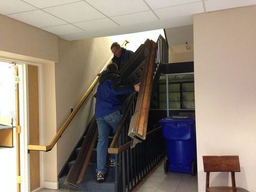 Mantel being carried down stairs