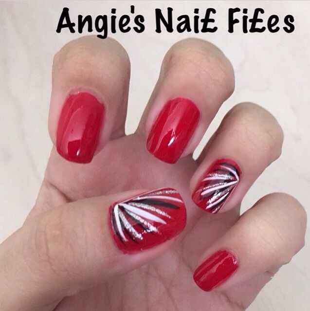 Fire red nails with white and black strips that I did :)