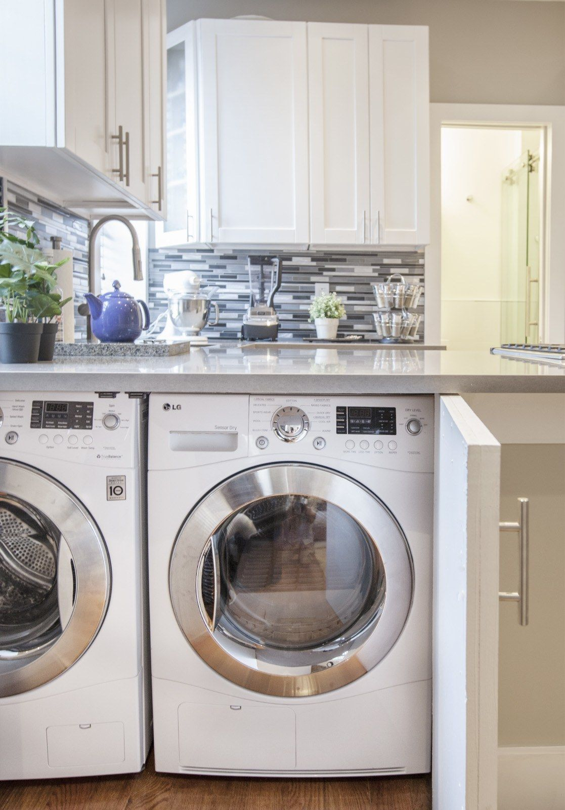 9 Small Laundry Room Ideas For The Tiniest Of Apartments Architectural Digest Small Laundry Rooms Small Laundry Room Laundry Room Storage
