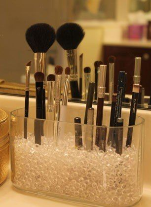 For a neat way to store brushes, Alyson from The Average Girls Guide filled a shallow glass vase with marbles to let makeup brushes and pencils stand upright—you'll never misplace an eyeliner pencil again. TheAverageGirlsGuide.com