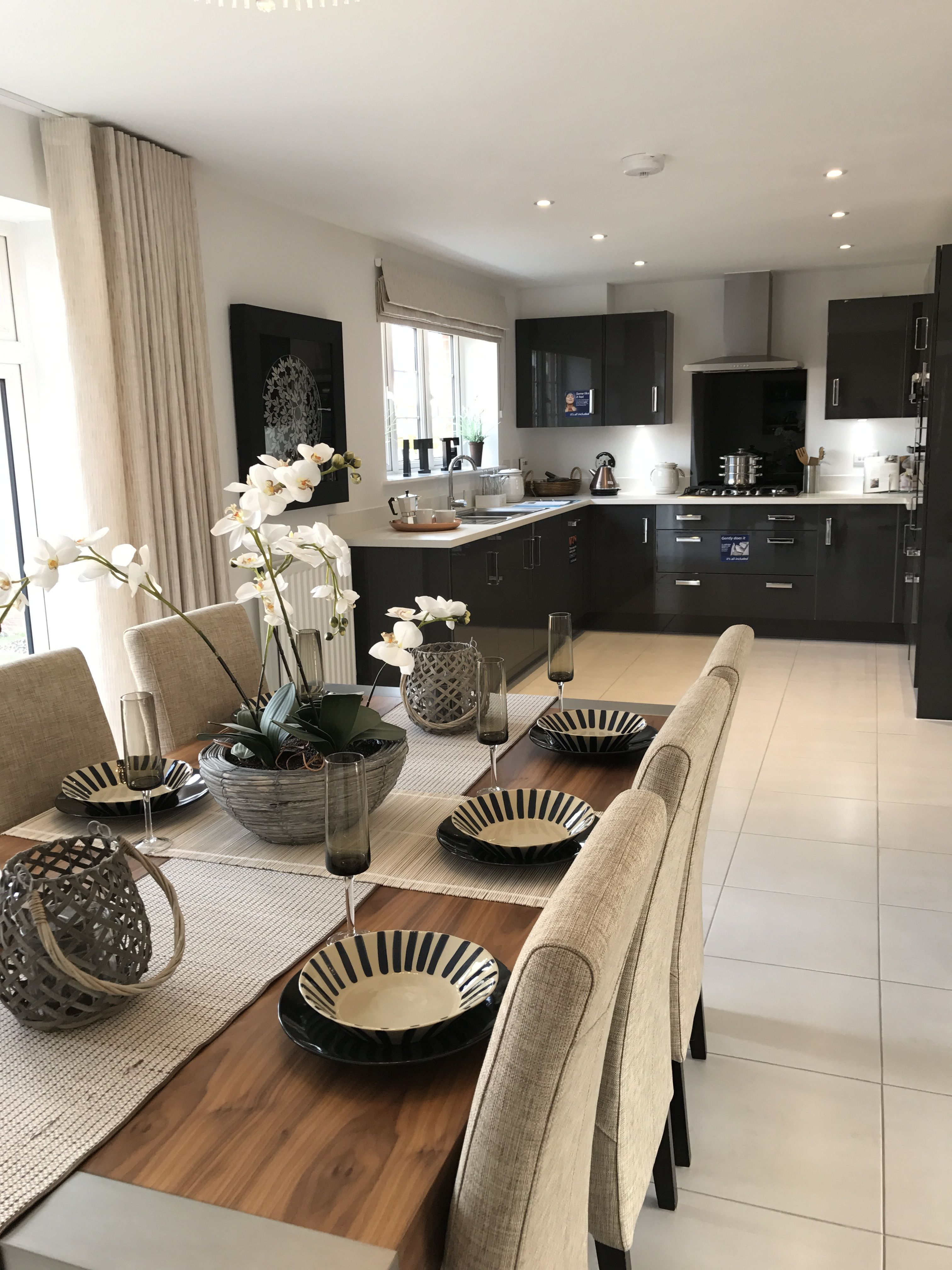 Modern kitchen, dining table, plates, flowers, new home   Open ...