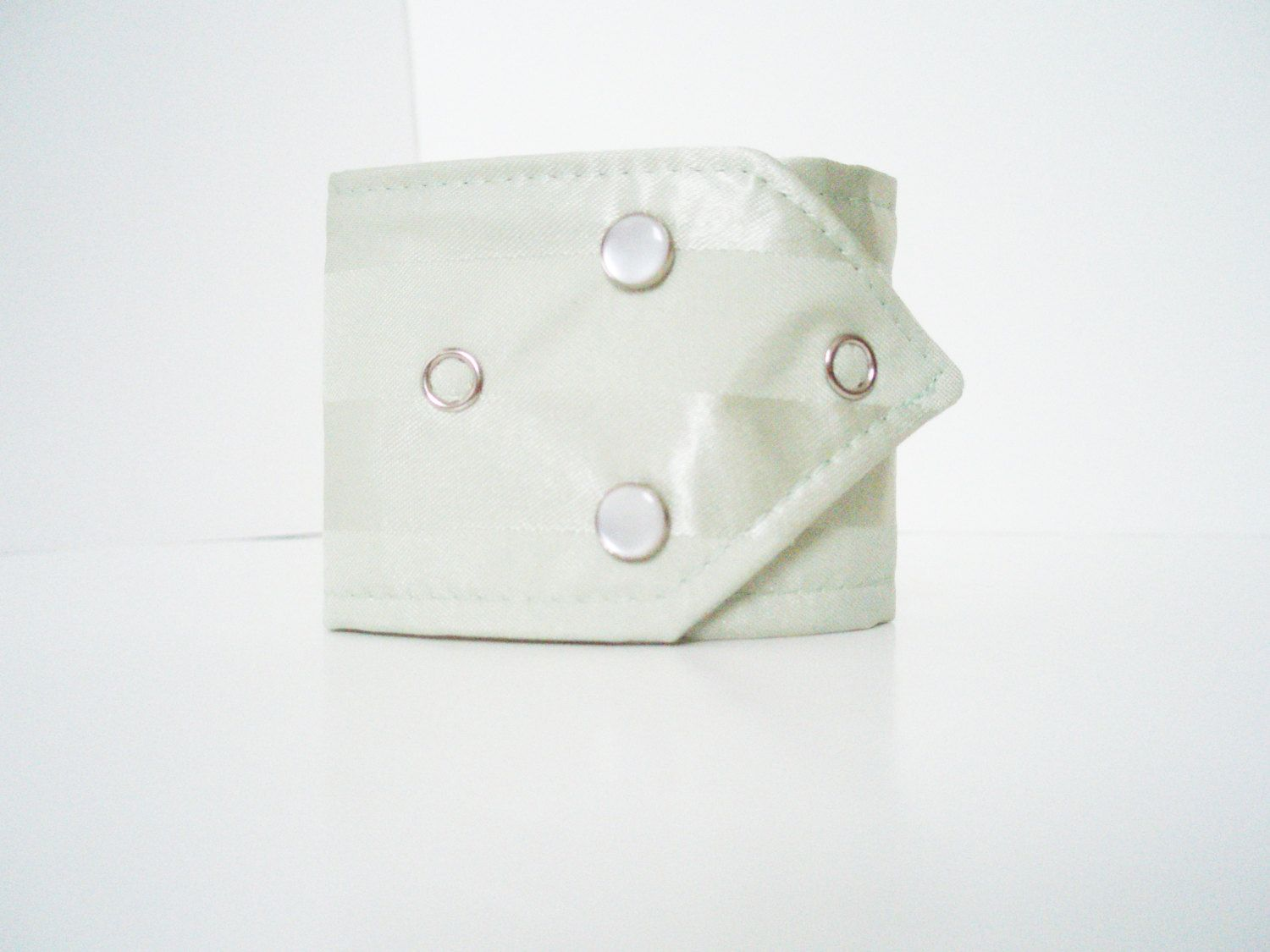 Fabric Cuff Bracelet with Pearl and Silver Snaps / For men and women / Urban Jewelry / Statement Jewelry. $10.00, via Etsy.