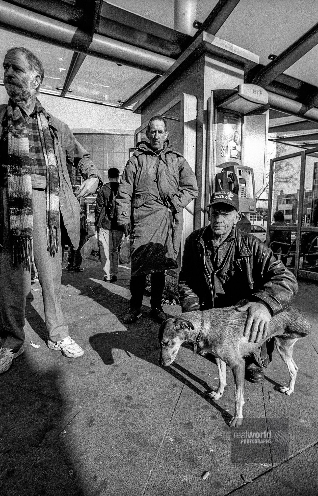 Local Wood Green characters with three-legged dog. London, England. #london #england #world #photojournalism #dog #woodgreen #malmo #sweden #documentary #people #places #cameraman #videographer #realworldvideo #newsphotography #photography #photojournalist #photographer #skane #garymoore #travelphotography #sony #realworldtelevision #videoproduction #sachtler #blackandwhitephotography #garymoorephotography #denmark #realworldphotographs #nikon