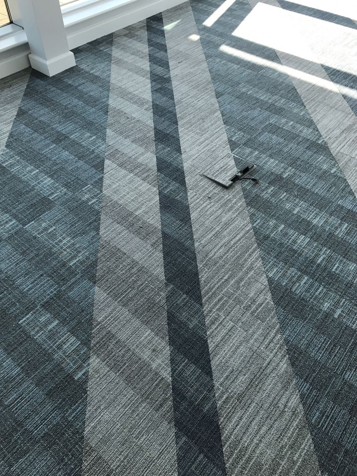 We Just Love How These Carpet Tiles Turned Out A Sea Of Blue And Grey Carpet Tiles Feature In This Co Grey Carpet Runner Stair Runner Carpet Patterned Carpet