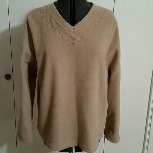 Camel colored fleece V-neck pullover Pretty tone-on-tone embroidery and beading around the neckline and on the wrists of this soft and flattering top Tops