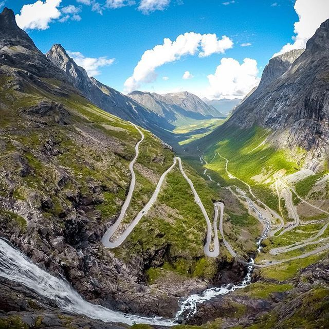 "Featured Photographer + #GoProGirl @emmadahlstrom ""During a #roadtrip in #Norway I passed this unique road named #Trollstigen. The road lingers up a steep mountain pass, next to several #waterfalls. Definitely one of the most scenic roads I've driven."" About the shot: #HERO4Silver, handheld with exposure lowered to -1.0 to not overexpose the sky. #GoPro #GoProTravel #instafollow #adventure #action #amazing"