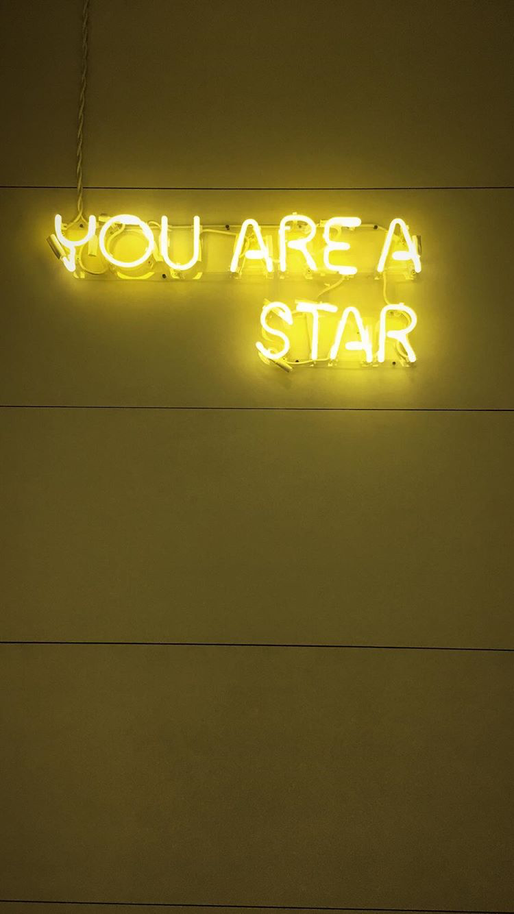 Yellow Neon Sign Black Background